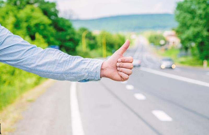 Thumb up gesture meaning. Cultural difference. Hitchhiking gesture. Thumb up inform drivers hitchhiking. But in some. Cultures gesture offensive risk to be royalty free stock image