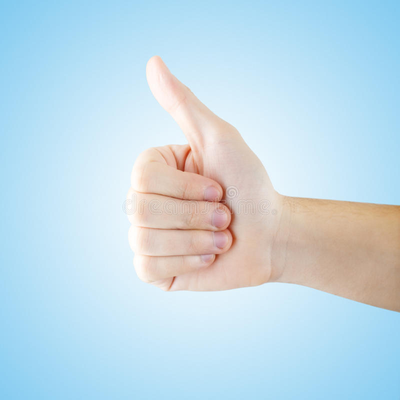Thumb up gesturing with clipping path. Added noise to the background royalty free stock photography