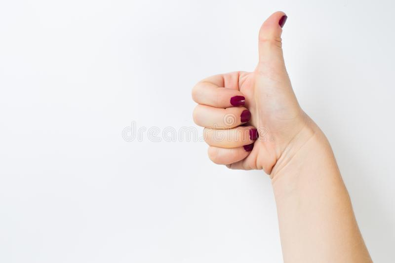 Thumb up hand sign. woman hand showing thumb up, like, good, approval, acceptance, okay, ok, positive hand gesture.  stock images