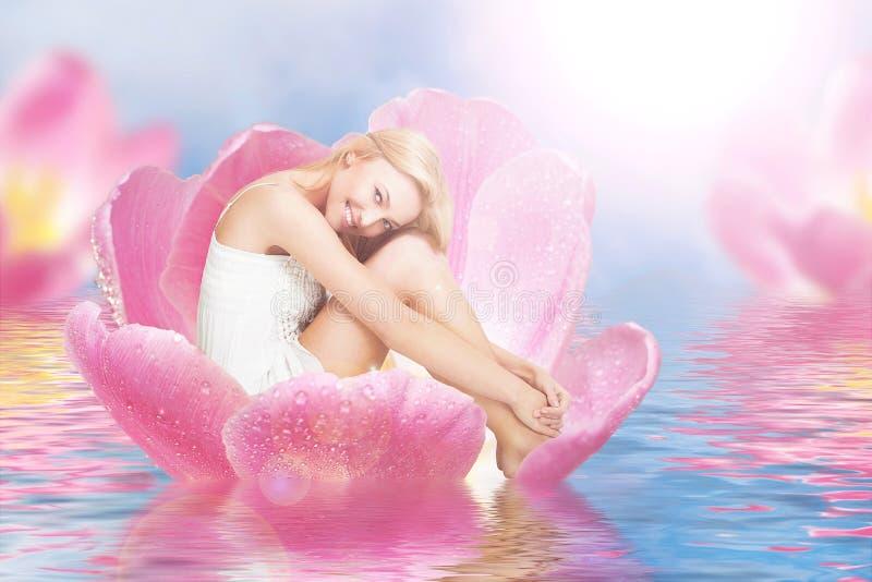 Thumbelina on tulip stock images