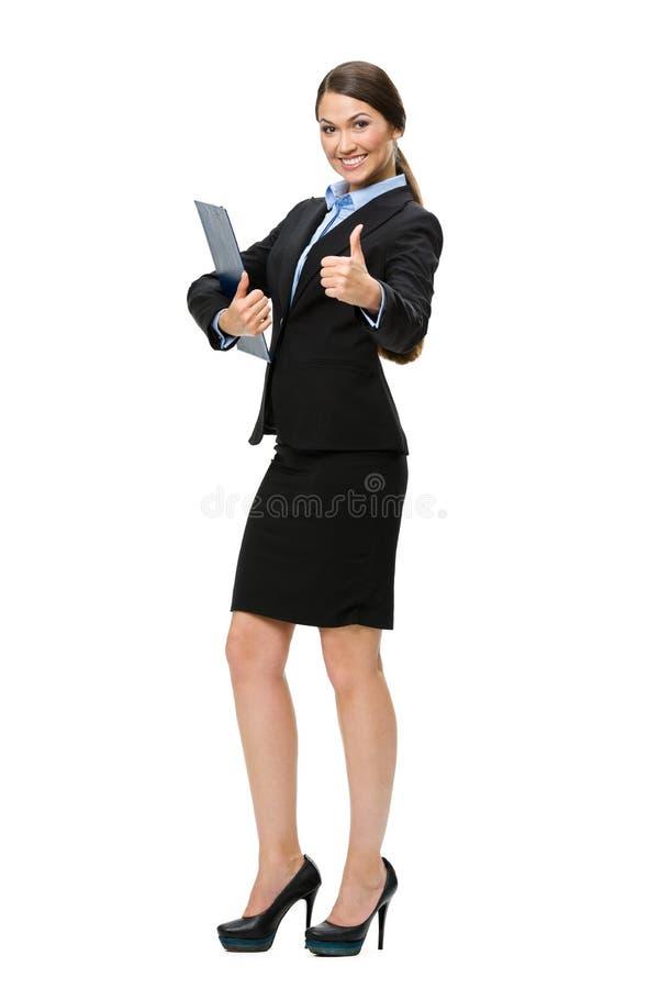 Thumbing вверх по коммерсантке с папкой стоковая фотография rf