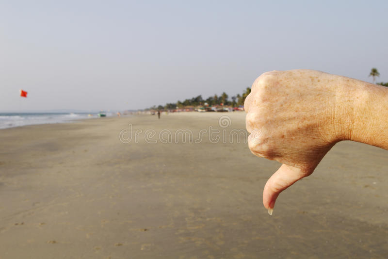 Thumbs down. Thumbs down for the beach stock photography