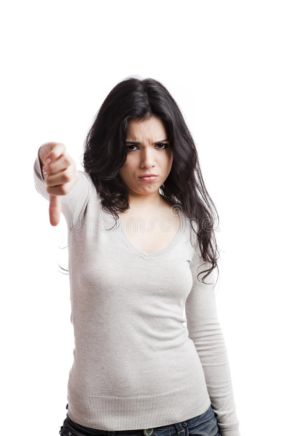 Thumbs down. Girl with thumbs down, isolated against a white background stock photo