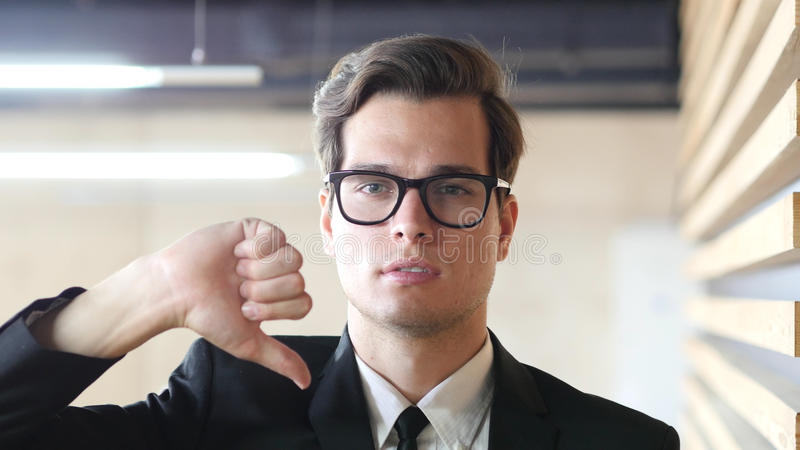 Thumbs Down Gesture by Man in Suit, Portrait royalty free stock images