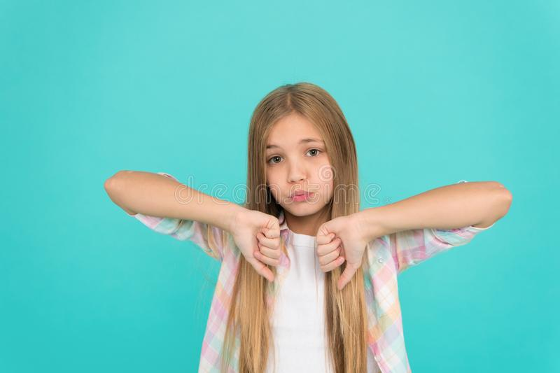 Thumbs down. Kid unhappy small baby. Dislikes concept. Reasons why kids dislike. Ways parents can change kids likes and. Dislikes. Girl little kid sad face royalty free stock photos