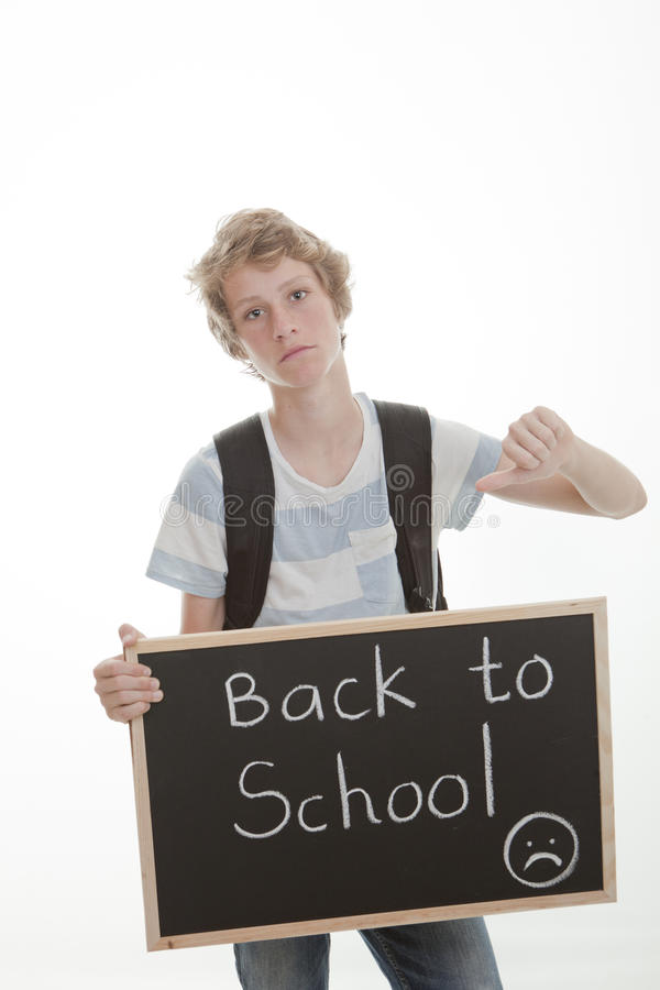 Thumbs down to school. Back to school, student with thumb down royalty free stock photo