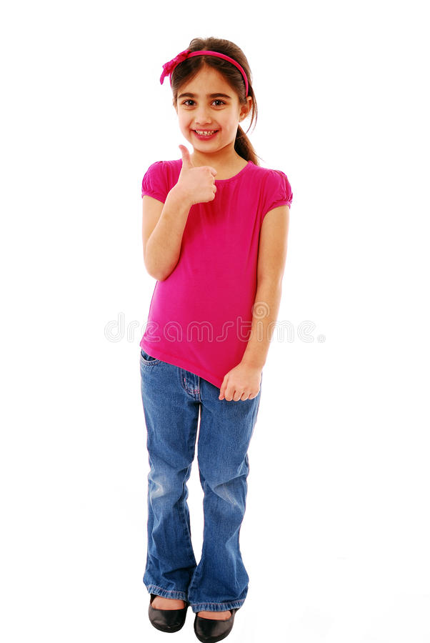 Thumbs up. Little girl giving the thumbs up isolated on white stock photography