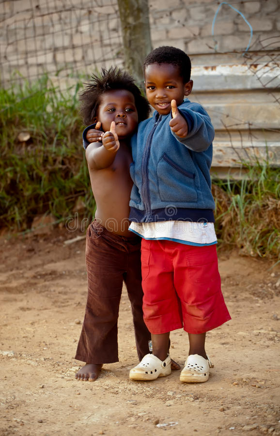 Thumbs up. Two small kiddies …hey hey, everything is ok royalty free stock photos