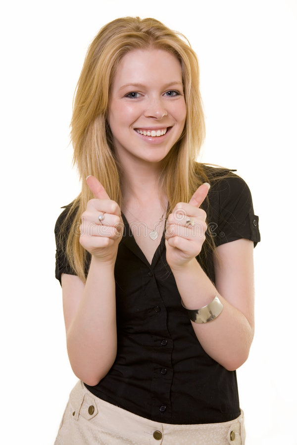 Thumbs up. Attractive young blond woman with two thumbs up with a laughing expression royalty free stock photo