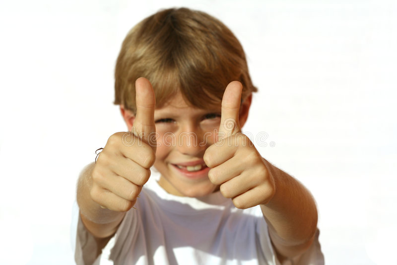 Thumbs up. Little boy holding thumbs up stock photography