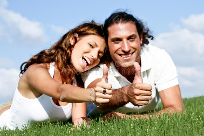 Thumbs-up couple royalty free stock image