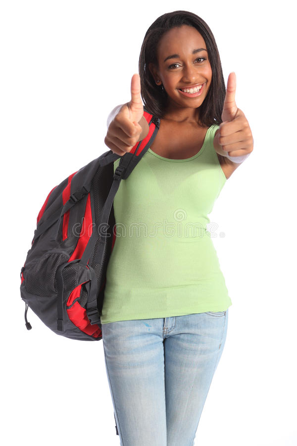 Thumbs up double success for African teenage girl royalty free stock images