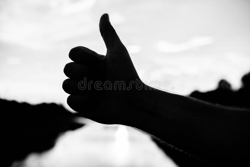 Thumbs up gesture sign of best choice approve and accept. Top places to visit in evening. Silhouette thumb up gesture in stock images