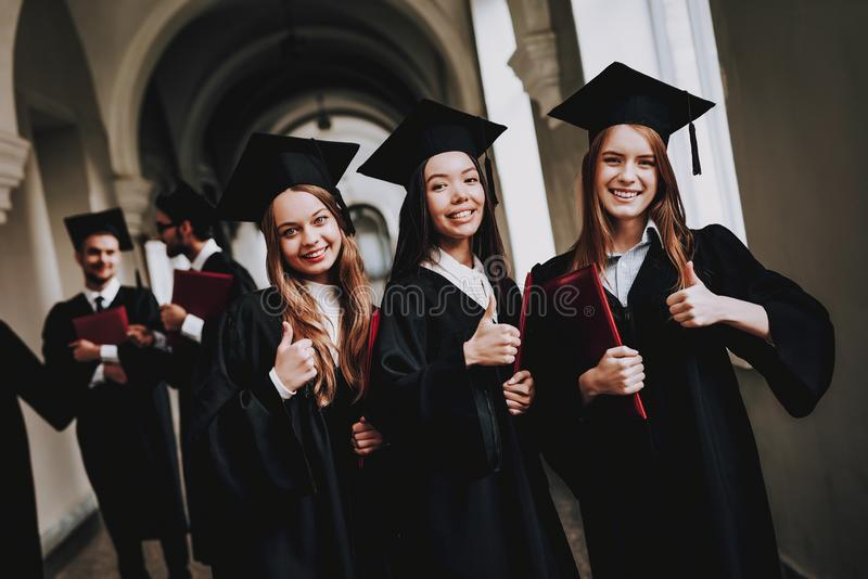 Thumbs Up. Girls. Good Mood. University. Cheerful. royalty free stock image