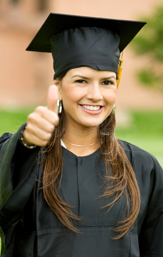 Thumbs up graduation woman