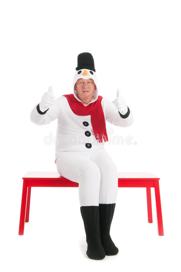 Thumbs up by human snowman. Human snowman is having thumbs up isolated over white background stock images