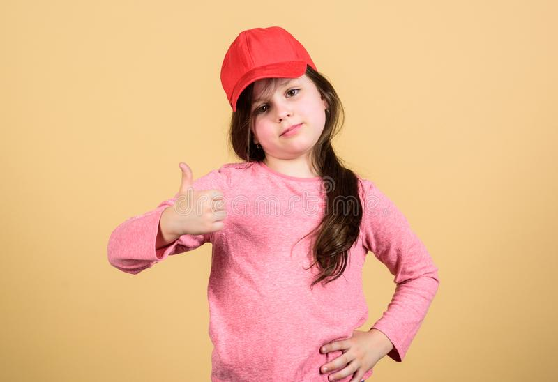Thumbs up if you feel beautiful. Adorable girl showing approval hand gesture. Cute small child gesturing approval sign royalty free stock photos