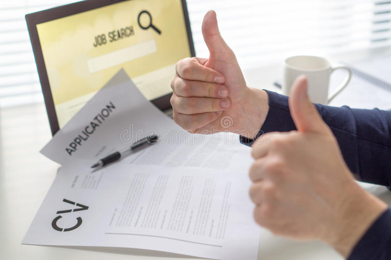 Thumbs up for job search. Applicant with positive attitude. Happy job seeker showing two hand gestures. stock images