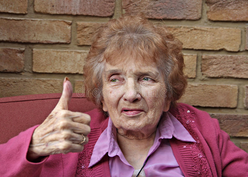 Thumbs up pensioner stock photos