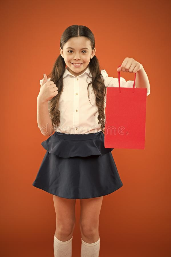Thumbs up for sale. Cute small child showing ok sign to purchase bought at sale on orange background. Happy little girl stock photos