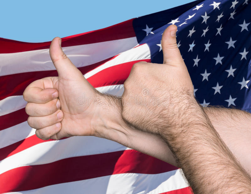 Thumbs up sign against of USA flag. Patriotic concept. Thumbs up sign against of United States of America flag royalty free stock photos