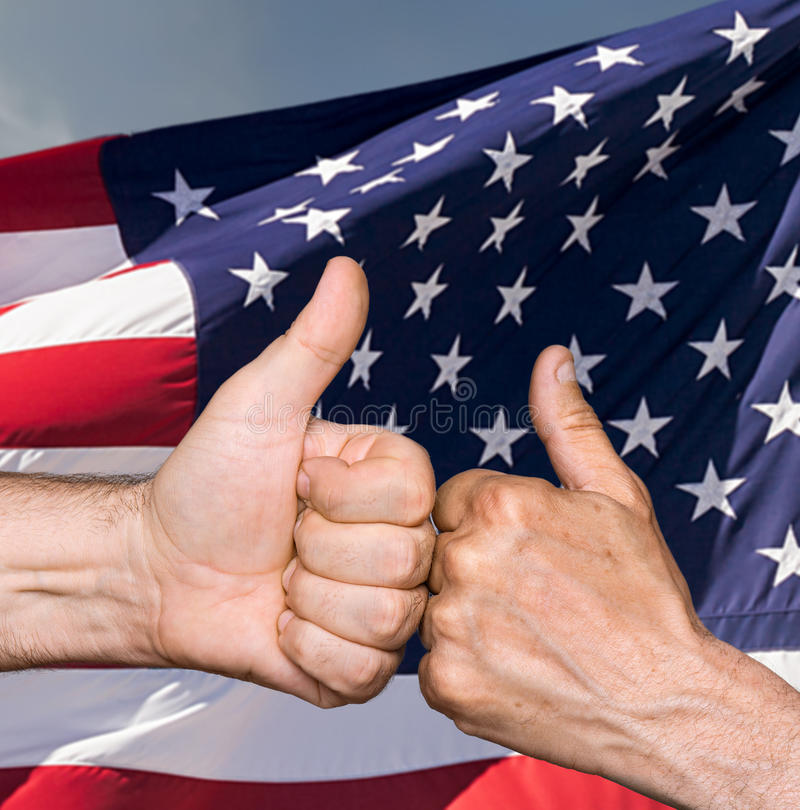 Thumbs up sign against of USA flag. Patriotic concept. Thumbs up sign against of United States of America flag stock images