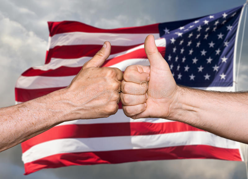 Thumbs up sign against of USA flag. Patriotic concept. Thumbs up sign against of United States of America flag stock photos