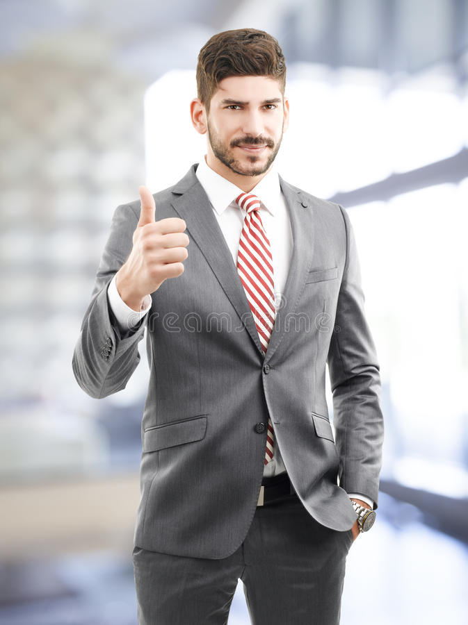Thumbs up. Successful businessman showing thumb up stock images
