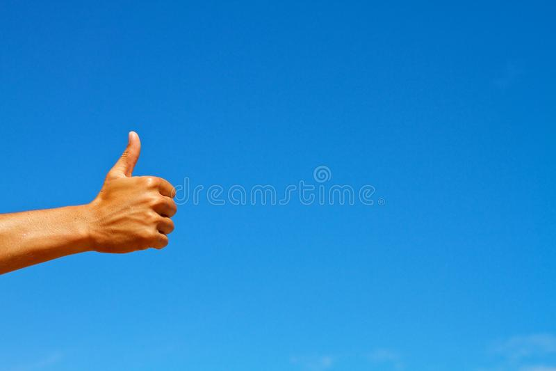 Download Thumbs Up Symbol Against Blue Sky Stock Image - Image of blue, okay: 26798045