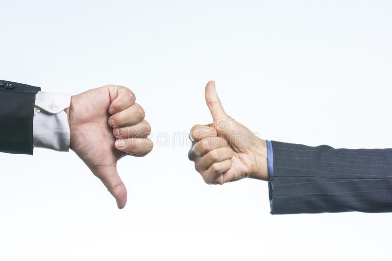 Thumbs up and Thumbs down sign. stock photos