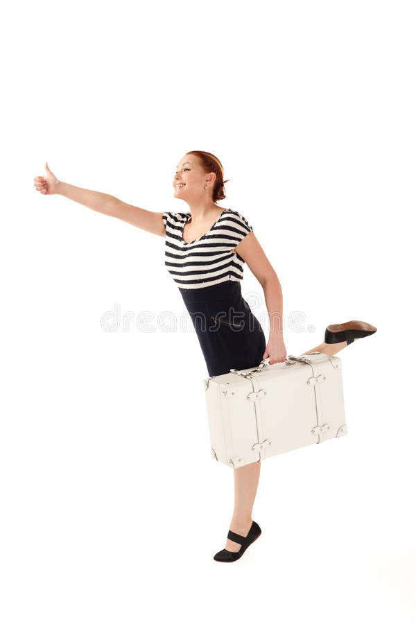 Thumbs up to catch your taxi. Woman with suitcase is trying to catch a taxi on isolated white background with shadows stock images