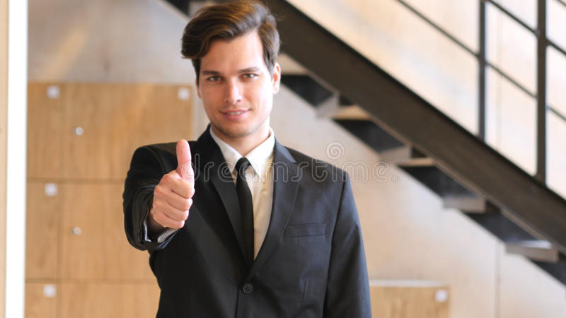 Thumbs Up by Walking Businessman in Screen royalty free stock photo