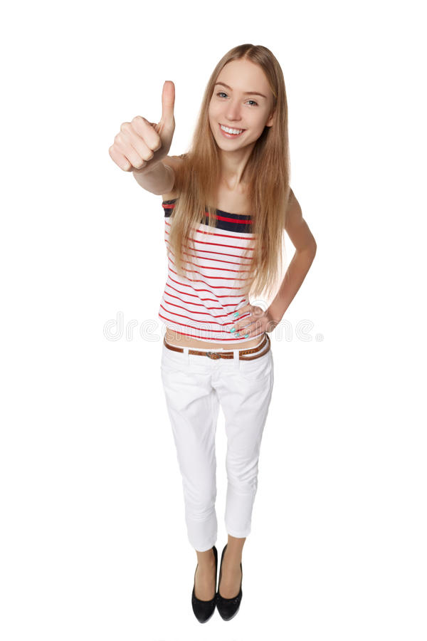 Thumbs up woman. Fun high angle full body portrait of a vivaciou royalty free stock photography