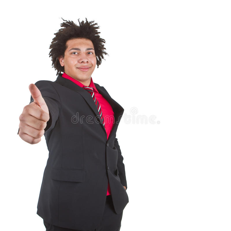 Thumbs up with this young black man. Young afro american businessman with great hair giving a thumbs up sign - isolated over white background stock images