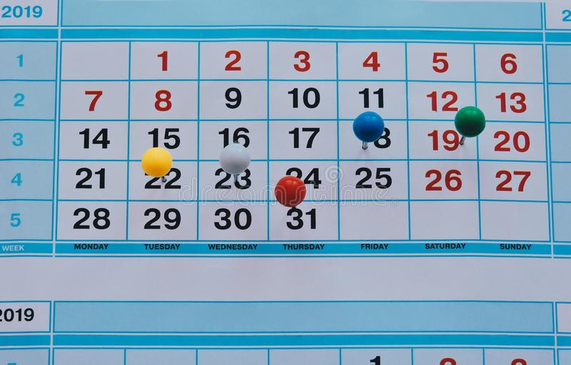 Thumbtack in calendar concept for busy,work space.Business meeting schedule, travel planning or project work royalty free stock images