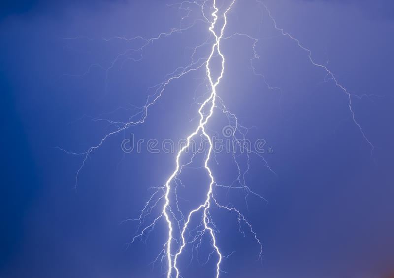 Thunder in the blue night sky stock photo