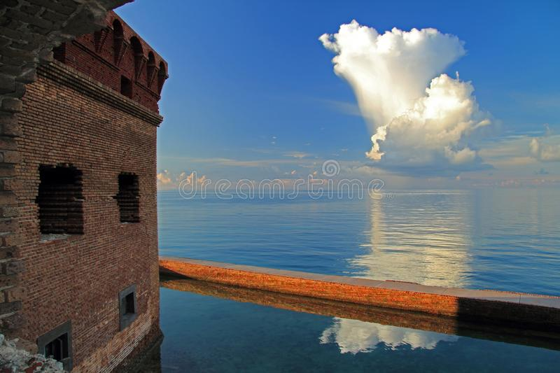 Thunder Clouds Form Over Dry Tortugas. Thunder clouds burst over Dry Tortugas National Park in the Florida Keys royalty free stock photo