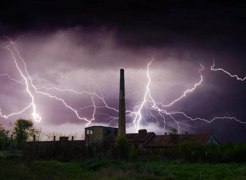 Thunder, lightnings and storm over abandoned factory in summer stock images