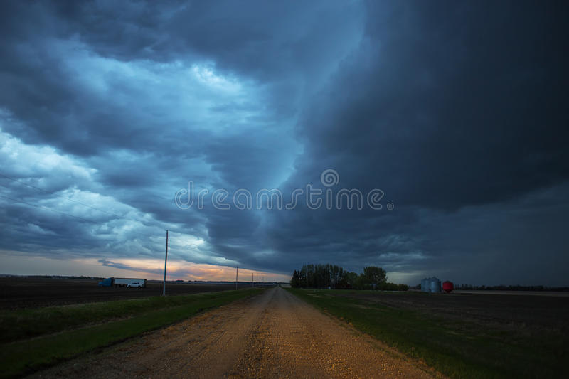 Thunder storm clouds over the prairies. Ominous thunder storm clouds over a agricultual prairie landscape at night royalty free stock photography