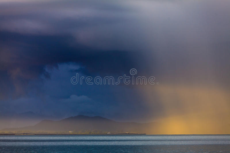 Download Thunder Storm With Rain Lit By The Sun Stock Image - Image: 16994375