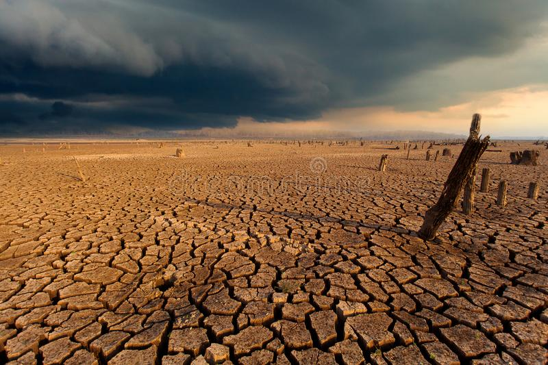 Thunder storm sky Rain clouds Cracked dry land. Surface, natural, level, nature, dirt, green, environmental, extreme, dirty, arid, new, ideas, warming, growth royalty free stock photo