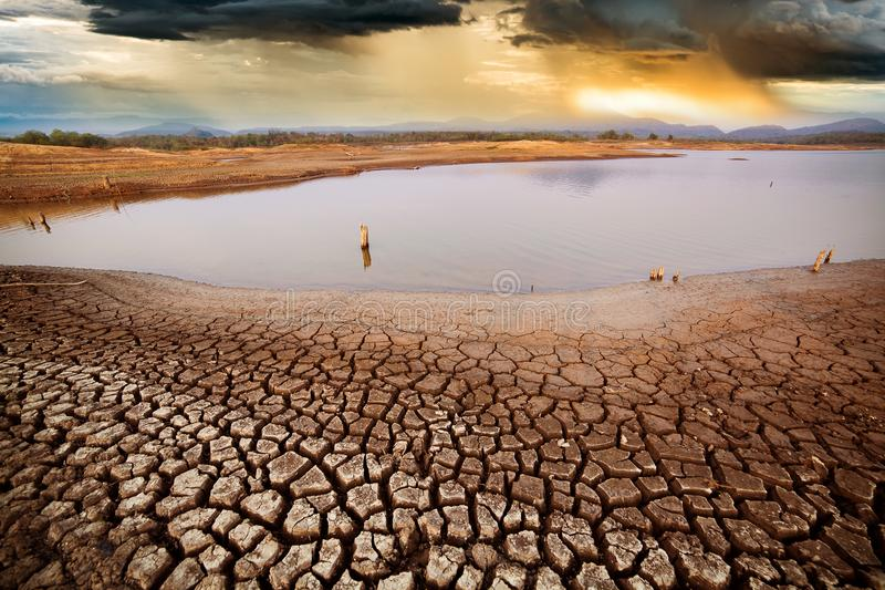 Thunder storm sky Rain clouds Cracked dry land without wate. Dirt, dramatic, climate, change, texture, seasons, natural, surface, nature, sunlight, field stock image
