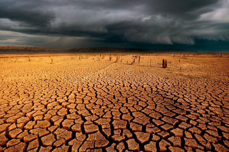 thunder storm sky Rain clouds  Cracked dry land without wate stock photography
