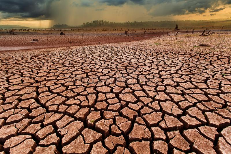 Thunder storm sky Rain clouds Cracked dry land without wate. Arid, cataclysm, catastrophe, change, clay, climate, damage, dead, dirt, disaster, dramatic stock image
