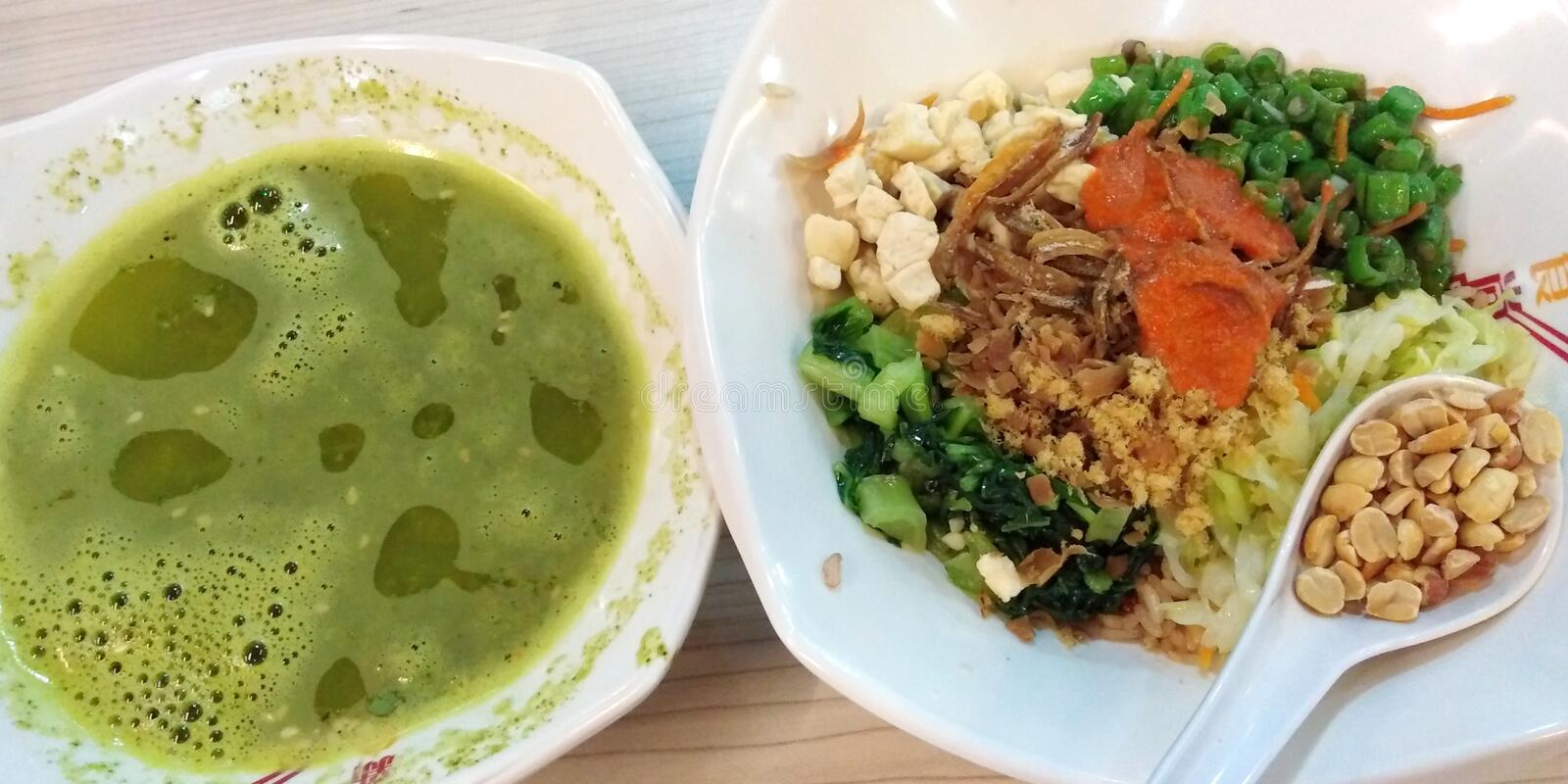 Thunder tea rice in Singapore. Hakka thunder tea rice, aka lei cha fan, in Singapore signature dish set meal lunch dinner vegetables vegetarian healthy food stock photos
