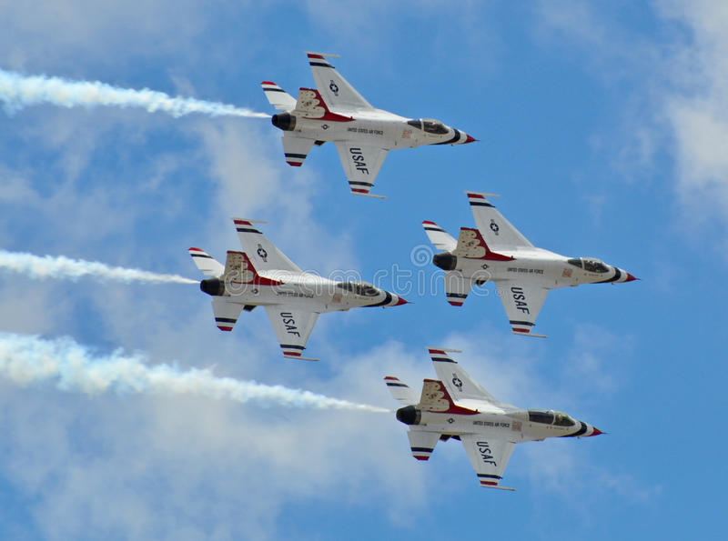 Thunderbirds Show at the US Air Force Graduation. A formation of four stunt jets releasing vapor trails of smoke in formation stock photography