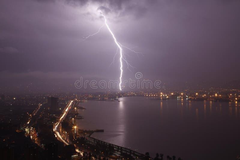 Thunderbolt on city. Powerful thunderbolt on Ä°zmir city royalty free stock images