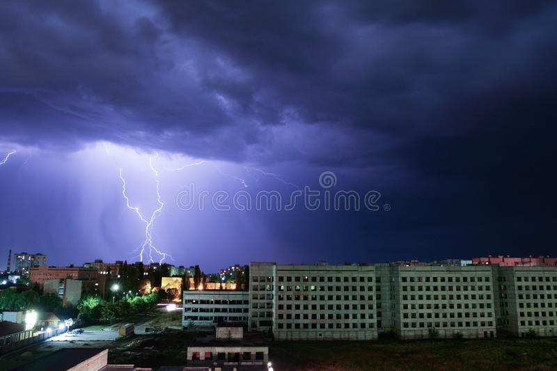 Thunderbolt over the house. Storm outside. Thunderstorm with lightning in the city royalty free stock photography