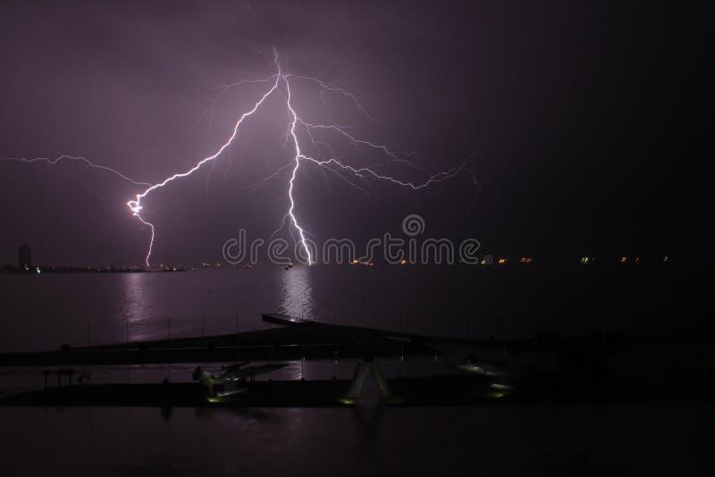 Lightning on sea. Thunderbolt on sea at night lightning royalty free stock image