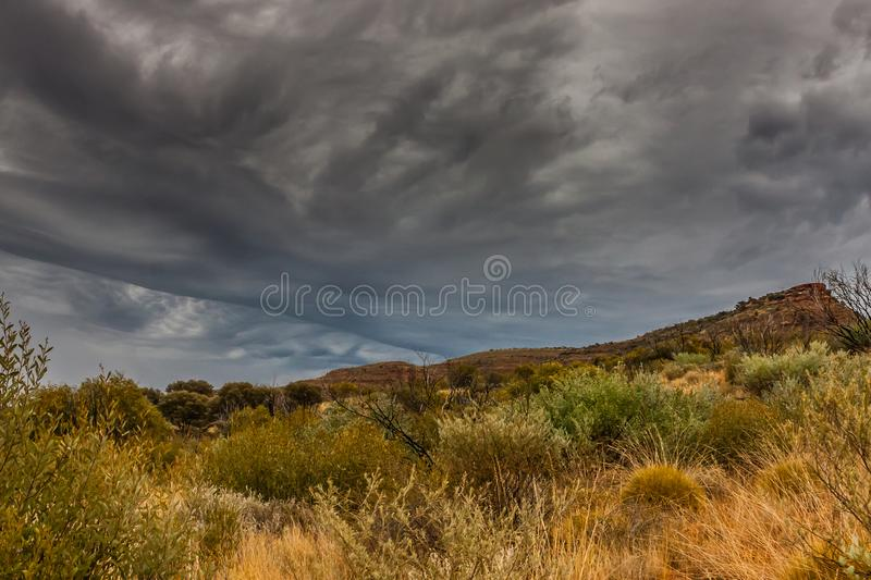 Thunderclouds over Kings Canyon, Northern Territory, Australia. Kings Canyon is a canyon in the Northern Territory of Australia located at the western end of the royalty free stock photo